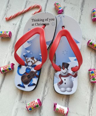 Christmas Flip Flos with a Snowman and Reindeer on.