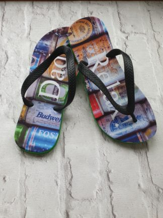Flip Flops with Dad Relax written on them