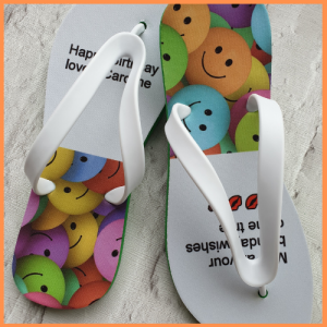 Flip Flops for a birthday celebration with emojis on.