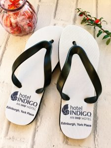 Flip flops with Hotel Indigo text