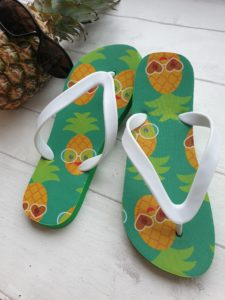 Green Flip Flops with smiling pineapples