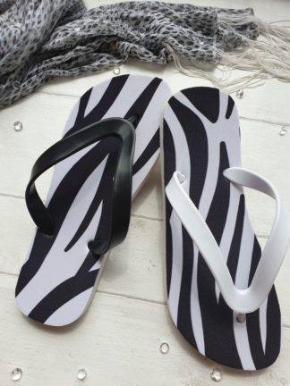 Flip Flos with a zebra print on them