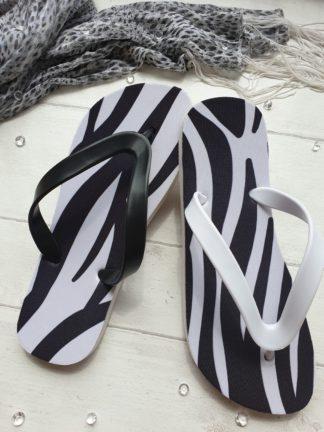 Flip Flos with a zebra print on them