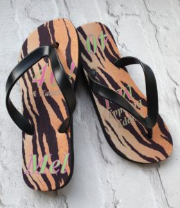 Animal print Flip Flops with 40th printed on them