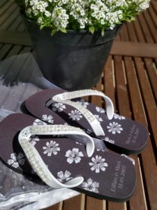 Flip Flops in a garden next to a plant potfor an anniversary i