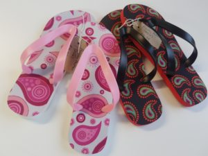 flip Flops with paisley pattern on them. One pink and one black