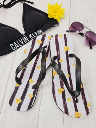 Flip Flops with black stripes and yellow hearts on them