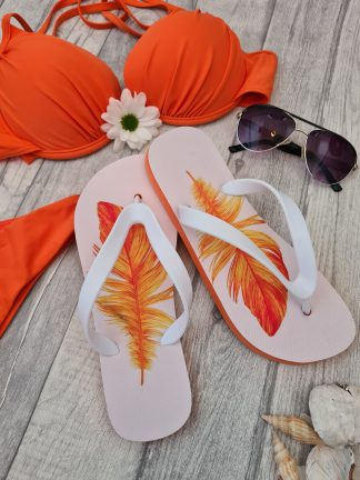 Flip Flops with prints of orange feathers on them, layed next to an orange bikini